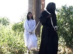 Two Monks In Black Suits Spanks Mouth-watering Rump Of Tied Up Dark-haired Renata