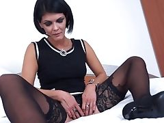 Foxy Raven-haired Cougar Thumbs Her Moist Snatch On The Sofa