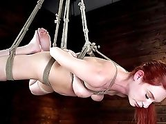 Smiling Red-haired Model Lacey Lennon Gets Revved On With Tying